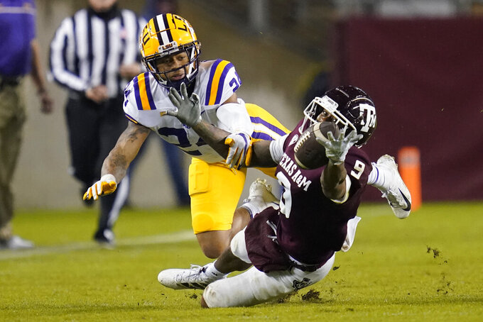 Texas A&M wide receiver Hezekiah Jones (9) tries to make a catch as LSU cornerback Derek Stingley Jr. (24) during the first half of an NCAA college football game, Saturday, Nov. 28, 2020. in College Station, Texas. (AP Photo/Sam Craft)