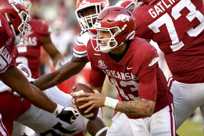 Arkansas quarterback Feleipe Franks (13) scrambles out of the pocket during the second half of the team's NCAA college football game against Georgia in Fayetteville, Ark., Saturday, Sept. 26, 2020. (AP Photo/Michael Woods)