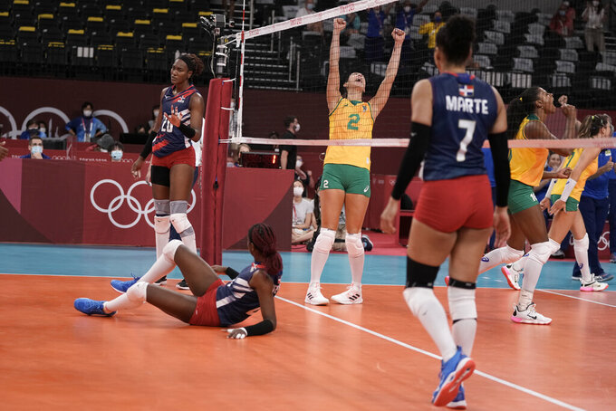 Brazil's Caroline de Oliveira Saad Gattaz celebrates a point during a women's volleyball preliminary round pool A match against the Dominican Republic, at the 2020 Summer Olympics, Tuesday, July 27, 2021, in Tokyo, Japan. (AP Photo/Manu Fernandez)