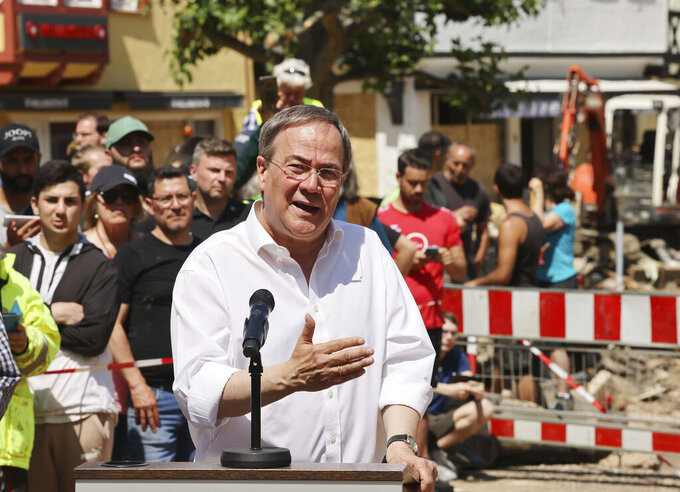 Armin Laschet (CDU), Minister President of North Rhine-Westphalia, gives a press conference in Bad Muenstereifel, Germany, Tuesday, July 20, 2021. Laschet and Chancellor Merkel have visited Bad Muenstereifel, which was badly affected by the storm. (Oliver Berg/DPA via AP, Pool)