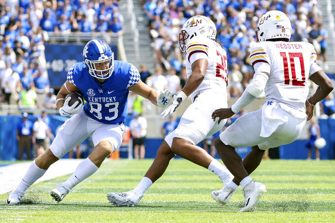 Kentucky tight end Justin Rigg (83) tries to run the ball past Louisiana-Monroe defenders during the second half of an NCAA college football game in Lexington, Ky., Saturday, Sept. 4, 2021. (AP Photo/Michael Clubb)