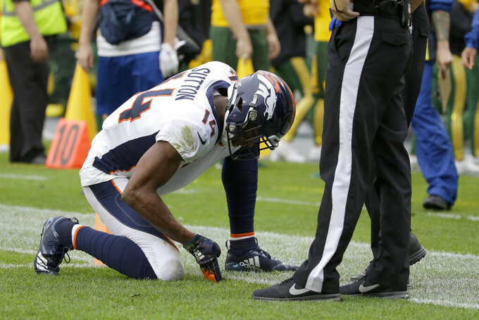 Denver Broncos wide receiver Courtland Sutton pleads with an official that his feet were in bounds after making a catch during the second half of an NFL football game against the Green Bay Packers, Sunday, Sept. 22, 2019, in Green Bay, Wis. (AP Photo/Mike Roemer)