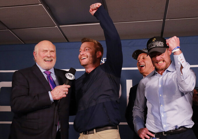 Los Angeles Rams head coach Sean McVay reacts in the locker room with broadcaster Terry Bradshaw after overtime of the NFL football NFC championship game against the New Orleans Saints, Sunday, Jan. 20, 2019, in New Orleans. The Rams won 26-23. (AP Photo/David J. Phillip)