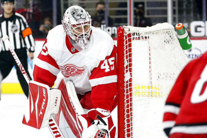 Detroit Red Wings goaltender Jonathan Bernier (45) eyes the puck against the Carolina Hurricanes during the second period of an NHL hockey game in Raleigh, N.C., Monday, April 12, 2021. (AP Photo/Karl B DeBlaker)