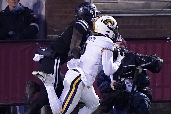 Missouri safety Joshuah Bledsoe, right, intercepts a pass intended for a Mississippi State receiver during the second half of an NCAA college football game, Saturday, Dec. 19, 2019, in Starkville, Miss. (AP Photo/Rogelio V. Solis)