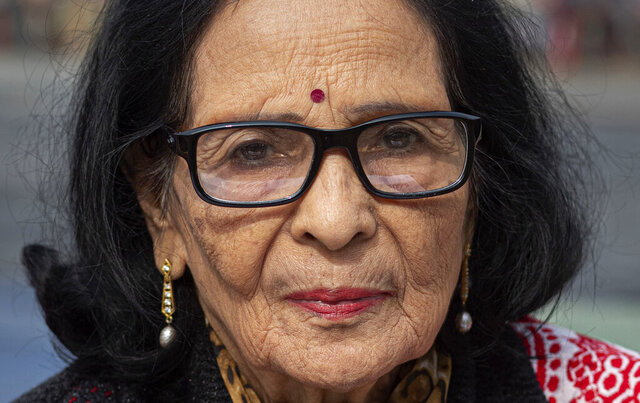 In this Monday, Dec. 23, 2019, photo, Mridula Kakati Hazarika, 78, participates in a protest against the Citizenship Amendment Act in Gauhati, India. Tens of thousands of protesters have taken to India's streets to call for the revocation of the law, which critics say is the latest effort by Narendra Modi's government to marginalize the country's 200 million Muslims. Hazarika said she has come to join the protest as she cannot sit inside her home while the country burns against CAA. (AP Photo/Anupam Nath)