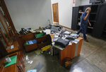 """FILE - In this Dec. 14, 2018 file photo, Confidencial director Carlos Fernando Chamorro, son of former President Violeta Barrios de Chamorro, walks through his ransacked offices while talking on his cellphone in Managua, Nicaragua. The prominent Nicaraguan journalist announced in a video posted to his Confidencial Facebook page on Monday, Jan. 21, 2019 that he had taken """"the painful decision to go into exile to ensure my freedom and physical safety, and above all to carry on independent journalism from Costa Rica.""""  (AP Photo/Alfredo Zuniga, File)"""