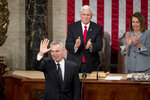 NATO Secretary General Jens Stoltenberg, left, accompanied by Vice President Mike Pence, center, and House Speaker Nancy Pelosi of Calif., right, waves after addressing a Joint Meeting of Congress on Capitol Hill in Washington, Wednesday, April 3, 2019, having been invited by the bipartisan leadership of the House of Representatives and the Senate. (AP Photo/Andrew Harnik)