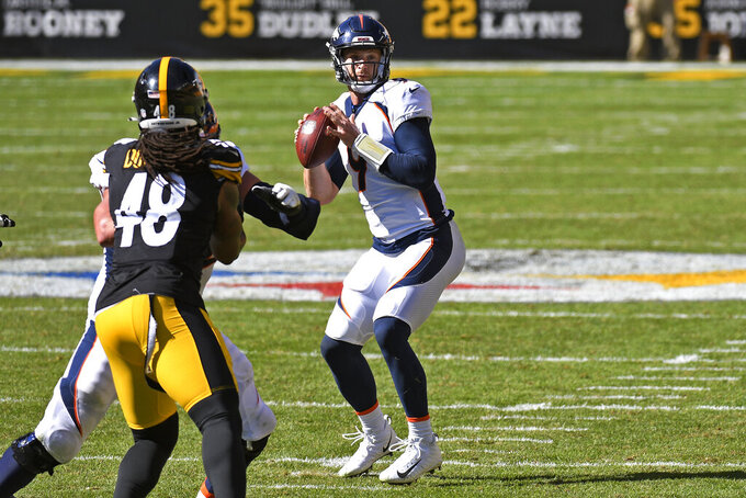 Denver Broncos quarterback Jeff Driskel (9) prepares to throw a touchdown pass to Noah Fant during the second half of an NFL football game against the Pittsburgh Steelers in Pittsburgh, Sunday, Sept. 20, 2020. (AP Photo/Don Wright)