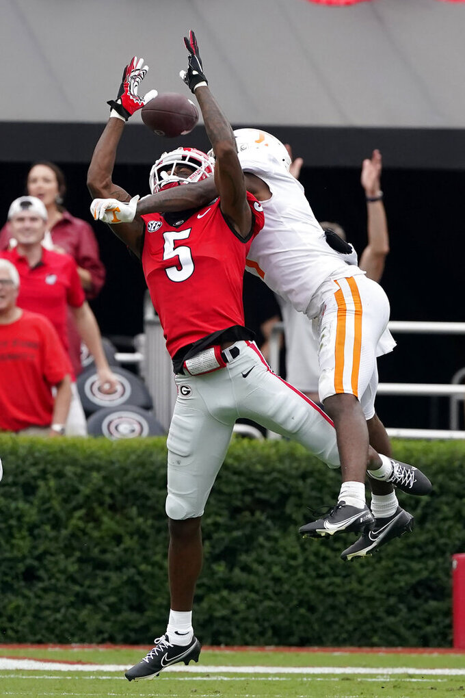 Tennessee defensive back Trevon Flowers (1) breaks up a pass intended for Georgia wide receiver Matt Landers (5) in the first half of an NCAA college football game Saturday, Oct. 10, 2020, in Athens, Ga. (AP Photo/John Bazemore)