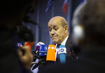 French Foreign Minister Jean-Yves Le Drian speaks with the media as he arrives for a meeting of EU foreign ministers at the European Convention Center in Luxembourg, Monday, Oct. 14, 2019. Some European Union nations are looking to extend moves against Turkey by getting more nations to ban arms exports to Ankara to protest the offensive in neighboring Syria. (AP Photo/Virginia Mayo)