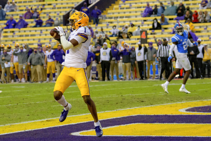LSU wide receiver Kayshon Boutte (1) makes a touchdown against Mississippi during the first half of an NCAA college football game in Baton Rouge, La., Saturday, Dec. 19, 2020. (AP Photo/Matthew Hinton)