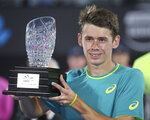 Alex De Minaur of Australia holds his runners' up trophy after losing to Daniil Medvedev of Russia in their men's final singles match at the Sydney International tennis tournament in Sydney, Saturday, Jan. 13, 2018. (AP Photo/Rick Rycroft)