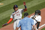 Detroit Tigers' Victor Reyes (22) slides past Pittsburgh Pirates catcher John Ryan Murphy, right, as home plate umpire Bill Welke, center, looks to make the call after Miguel Cabrera singled in the fifth inning of a baseball game, Sunday, Aug. 9, 2020, in Pittsburgh. (AP Photo/Keith Srakocic)