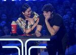 Lana Condor, left, and Noah Centineo accept the award for best kiss for