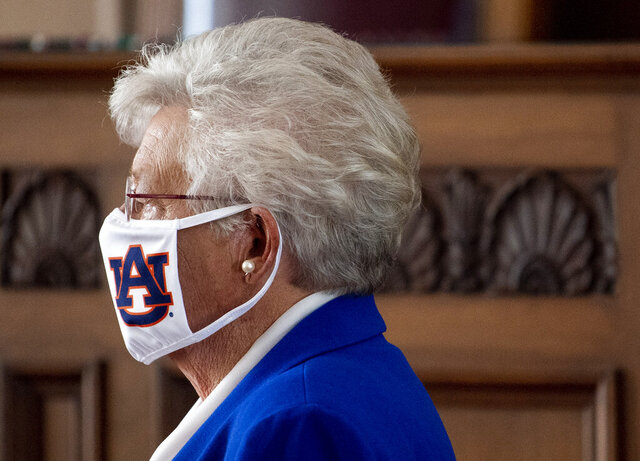 Alabama Gov. Kay Ivey wears an Auburn University mask as she arrives to announce a statewide mask order during a news conference in the state capitol building in Montgomery, Ala., on Wednesday, July 15, 2020. (Mickey Welsh/The Montgomery Advertiser via AP)