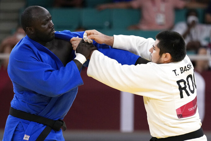 Mbagnick Ndiaye of Senegal, left, and Tamerlan Bashaev of the Russian Olympic Committee compete during their men's +100kg elimination round judo match at the 2020 Summer Olympics, Friday, July 30, 2021, in Tokyo, Japan. (AP Photo/Vincent Thian)