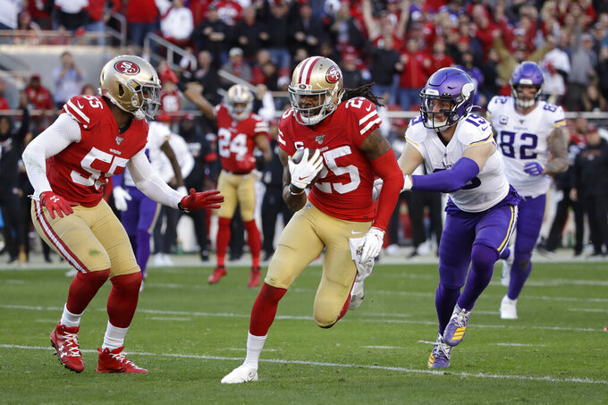 San Francisco 49ers cornerback Richard Sherman (25) runs in front of Minnesota Vikings wide receiver Adam Thielen as 49ers defensive end Dee Ford (55) looks on after Sherman intercepted a pass during the second half of an NFL divisional playoff football game, Saturday, Jan. 11, 2020, in Santa Clara, Calif. (AP Photo/Marcio Jose Sanchez)