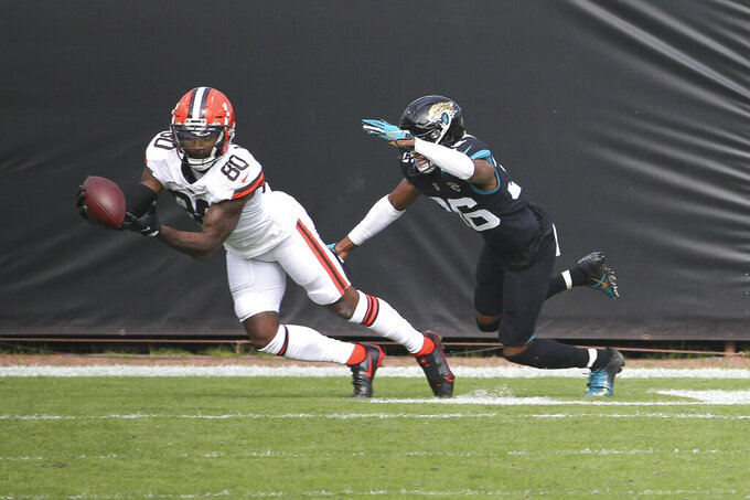 Cleveland Browns wide receiver Jarvis Landry (80) catches a touchdown pass in front of Jacksonville Jaguars cornerback Luq Barcoo, right, during the first half of an NFL football game, Sunday, Nov. 29, 2020, in Jacksonville, Fla. (AP Photo/Stephen B. Morton)