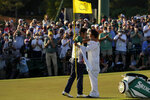Hideki Matsuyama, of Japan, hugs his caddie Shota Hayafuji after winning the Masters golf tournament on Sunday, April 11, 2021, in Augusta, Ga. (AP Photo/Gregory Bull)