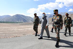 In this handout photo provided by the Press Information Bureau, Indian Prime Minister Narendra Modi walks with soldiers during a visit to the Ladakh area, India, Friday, July 3, 2020. Modi made an unannounced visit Friday to a military base in remote Ladakh region bordering China where the soldiers of the two countries have been facing off for nearly two months. Modi's visit comes in the backdrop of massive Indian army build-up in Ladakh region following hand-to-hand combat between Indian and Chinese soldiers on June 15 that left 20 Indian soldiers dead and dozens injured, the worst military confrontation in over four decades between the Asian giants. (Press Information Bureau via AP)