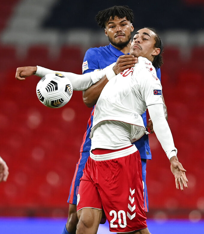 England's Tyrone Mings and Denmark's Yussuf Poulsen battle for the ball during the UEFA Nations League soccer match between England and Denmark at Wembley Stadium in London, England, Wednesday, Oct. 14, 2020. (Daniel Leal-Olivas/Pool via AP)