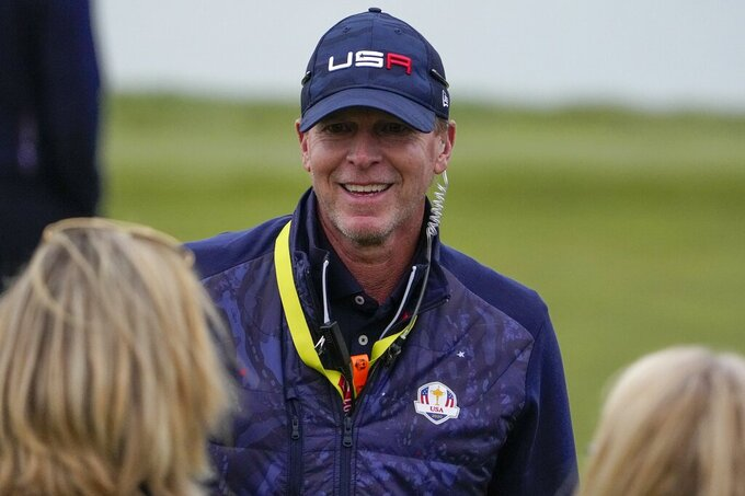 Team USA captain Steve Stricker smiles during a four-ball match the Ryder Cup at the Whistling Straits Golf Course Saturday, Sept. 25, 2021, in Sheboygan, Wis. (AP Photo/Jeff Roberson)