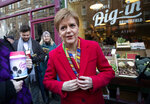 SNP leader Nicola Sturgeon, poses for a photo, during a visit to Digin Community Greengrocer in Edinburgh, Scotland, on the last day of the General Election campaign trail, Wednesday, Dec. 11, 2019. Britain goes to the polls on Dec. 12. (Jane Barlow/PA via AP)