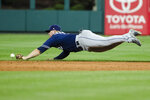 San Diego Padres' Ty France misses a ball hit by Philadelphia Phillies' Jean Segura during the sixth inning of a baseball game Friday, Aug. 16, 2019, in Philadelphia. (AP Photo/Matt Rourke)