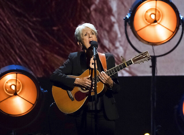 FILE - In this April 7, 2017 file photo, inductee Joan Baez performs at the 2017 Rock & Roll Hall of Fame induction ceremony at the Barclays Center in New York. Singer, songwriter, activist and Rock and Roll Hall of Fame member Baez is this year's recipient of the Woody Guthrie Prize, an award that recognizes artists who speak out for the less fortunate. Baez will be honored with a virtual ceremony on Aug. 16, 2020.  (Photo by Charles Sykes/Invision/AP File)