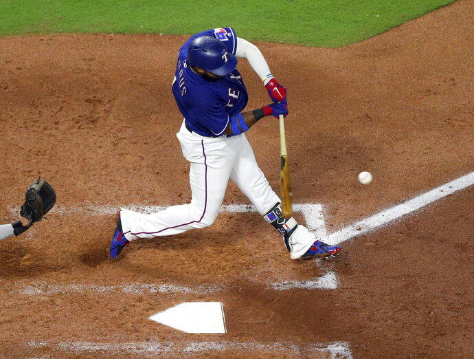 Texas Rangers' Elvis Andrus (1) connects for a home run in the fourth inning in a baseball game against the Los Angeles Angels Tuesday, Sept. 4, 2018, in Arlington, Texas. (AP Photo/Richard W. Rodriguez)