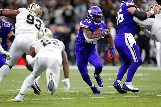 Minnesota Vikings running back Dalvin Cook (33) carries in the first half of an NFL wild-card playoff football game against the New Orleans Saints, Sunday, Jan. 5, 2020, in New Orleans. (AP Photo/Brett Duke)