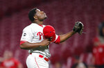 Philadelphia Phillies relief pitcher Hector Neris looks skyward after the team's baseball game against the Cincinnati Reds, Tuesday, Sept. 3, 2019, in Cincinnati. The Phillies won 6-2. (AP Photo/Gary Landers)