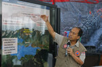 National Disaster Mitigation Agency spokesman Sutopo Purwo Nugroho gestures during a press conference in Jakarta, Indonesia, Monday, March 18, 2019. Flash floods and mudslides triggered by days of torrential downpours tore through mountainside villages in Indonesia's easternmost province, killing dozens of people and leaving dozens missing(AP Photo/Tatan Syuflana)