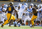 California's Ashtyn Davis (27) comes down with an onside kick by North Carolina during the second half of an NCAA college football game, Saturday, Sept. 1, 2018, in Berkeley, Calif. Cal won 24-17. (AP Photo/D. Ross Cameron)