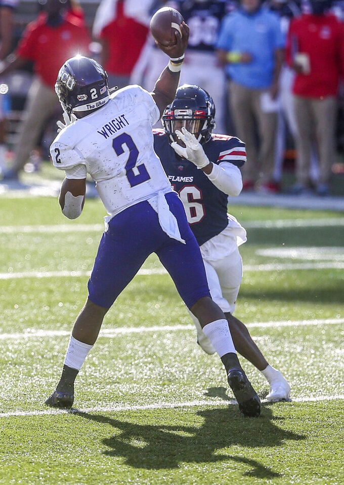 Western Carolina quarterback Mark Wright (2) makes a pass as he is pressured by Liberty cornerback Quinton Reese (16) during the second half of an NCAA football game Saturday, Nov. 14, 2020, in Lynchburg, Va. (AP Photo/Shaban Athuman)