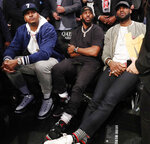 Carmelo Anthony, Chris Paul and LeBron James, from left, watch during the first half of an NBA basketball game between the Brooklyn Nets and the Miami Heat, Wednesday, April 10, 2019, in New York. The three were watching Miami Heat guard Dwyane Wade play the final NBA game of his career. (AP Photo/Kathy Willens)