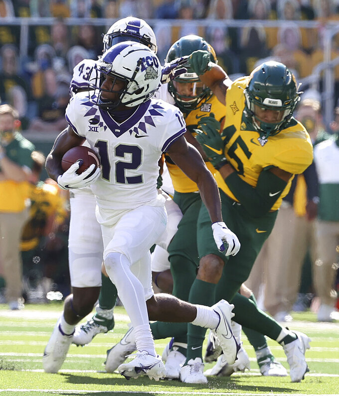 TCU wide receiver Derius Davis (12) runs past the Baylor special teams for a touchdown in the first half of an NCAA college football game in Waco, Texas, Saturday, Oct. 31, 2020. (Jerry Larson/Waco Tribune-Herald via AP)