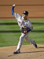 Houston Astros pitcher Zack Greinke works against the Oakland Athletics in the first inning of a baseball game Friday, Aug. 7, 2020, in Oakland, Calif. (AP Photo/Ben Margot)