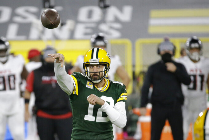 Green Bay Packers quarterback Aaron Rodgers (12) throws during the first half of an NFL football game against the Atlanta Falcons, Monday, Oct. 5, 2020, in Green Bay, Wis. (AP Photo/Mike Roemer)