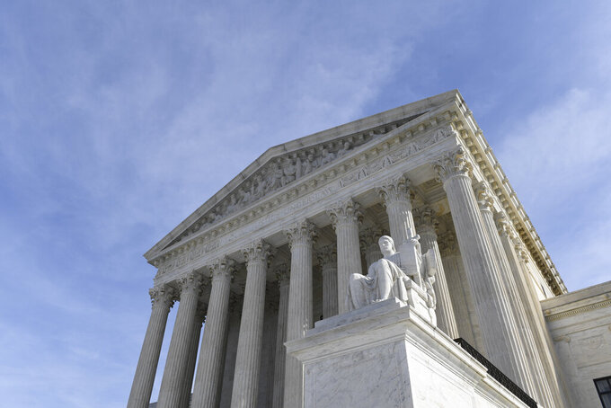 """FILE - In this Nov. 11, 2019, file photo, a view of the Supreme Court in Washington. The Supreme Court appears ready to prevent thousands of people living in the U.S. for humanitarian reasons from applying to become permanent residents. The justices seemed favorable to arguments made by the Biden administration on April 19, 2021, that federal immigration law prohibits people who entered the country illegally and now have Temporary Protected Status from seeking """"green cards"""" to remain in the country permanently. (AP Photo/Susan Walsh, File)"""