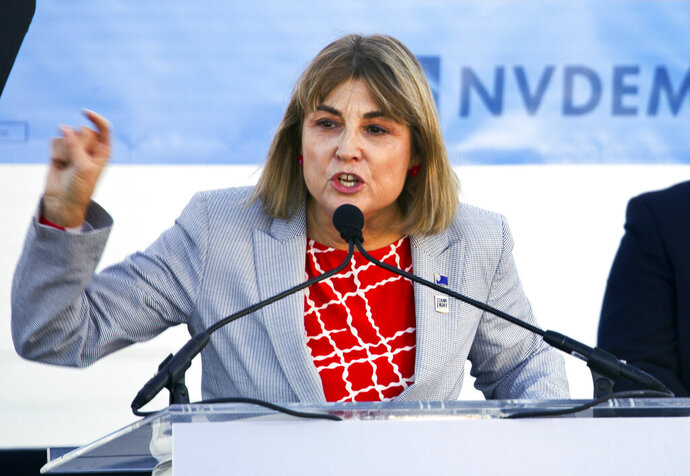 FILE - In this Oct. 20, 2018, file photo, Kate Marshall speaks to supporters at a rally during her ultimately successful campaign for lieutenant governor in downtown Las Vegas. A panel formed by Nevada's governor to encourage statewide participation in the 2020 U.S. Census is stressing the importance of people being counted, following a fight in Washington whether to include a citizenship question. Marshall heads the Nevada Complete Count Committee. She tells the Las Vegas Sun that for each Nevadan who isn't counted in the census, the state could lose about $20,000 in federal funds. (Christopher DeVargas/Las Vegas Sun via AP, File)