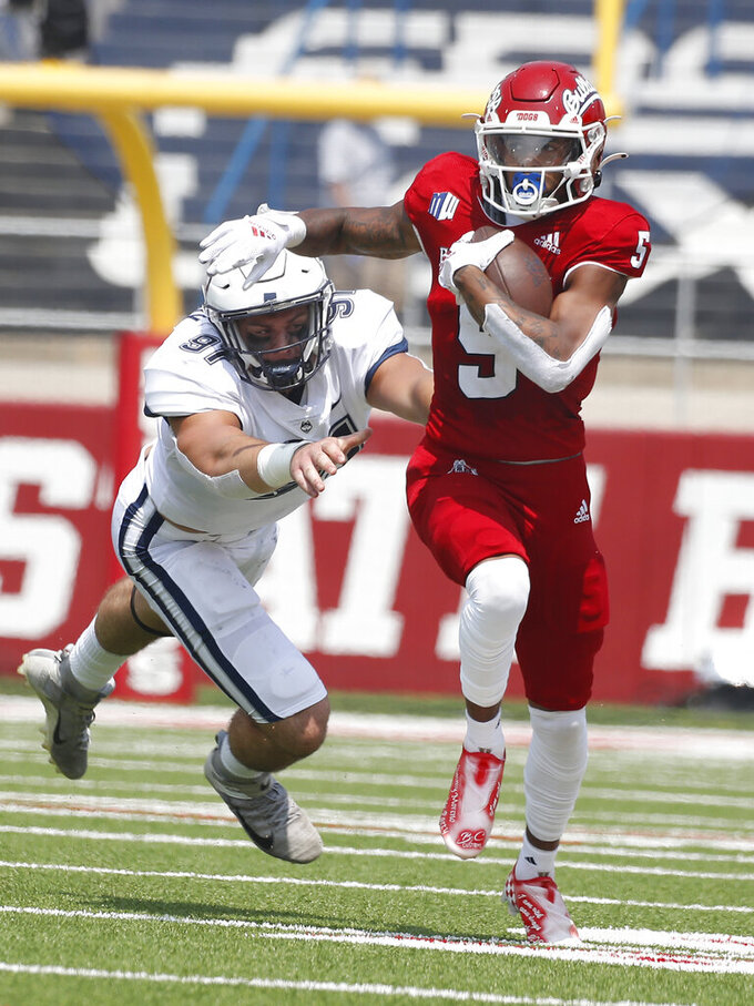 Fresno State's wide receiver Jalen Cropper, right, runs past Connecticut's Collin McCarthy during the first half of an NCAA college football game in Fresno, Calif., Saturday, Aug. 28, 2021. (AP Photo/Gary Kazanjian)