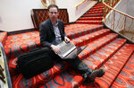 FILE - In this Friday Nov. 9, 2012 file photo, Nate Silver, statistician, unabashed numbers geek, author and creator of the much-read FiveThirtyEight blog at The New York Times, sits on the stairs at Allegro hotel in downtown Chicago. (AP Photo/Nam Y. Huh, File)
