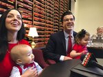 FILE - In this Jan. 25, 2019 file photo, Republican state Sen. Wil Schroder, right, smiles with his family after filing to run for attorney general in Frankfort, Ky. Schroder and Daniel Cameron, a former aide to Sen. Mitch McConnell, are battling over their conservative credentials in the Republican primary for state attorney general. The winner will face former Kentucky Attorney General Greg Stumbo, who held the office from 2004 to 2008, in the November general election.(AP Photo/Adam Beam, File)