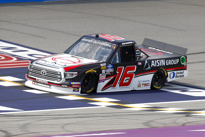 Austin Hill crosses the finish line to win a NASCAR Truck Series race at Michigan International Speedway in Brooklyn, Mich., Saturday, Aug. 10, 2019. (AP Photo/Paul Sancya)