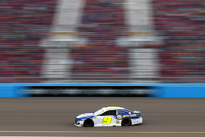 Chase Elliott races through Turn 4 en-route to the season championship during the NASCAR Cup Series auto race at Phoenix Raceway, Sunday, Nov. 8, 2020, in Avondale, Ariz. (AP Photo/Ralph Freso)