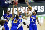 Morehead State's Skyelar Potter (5) pulls down a rebound during the second half of a college basketball game against West Virginia in the first round of the NCAA tournament at Lucas Oil Stadium Saturday, March 20, 2021, in Indianapolis. (AP Photo/Mark Humphrey)