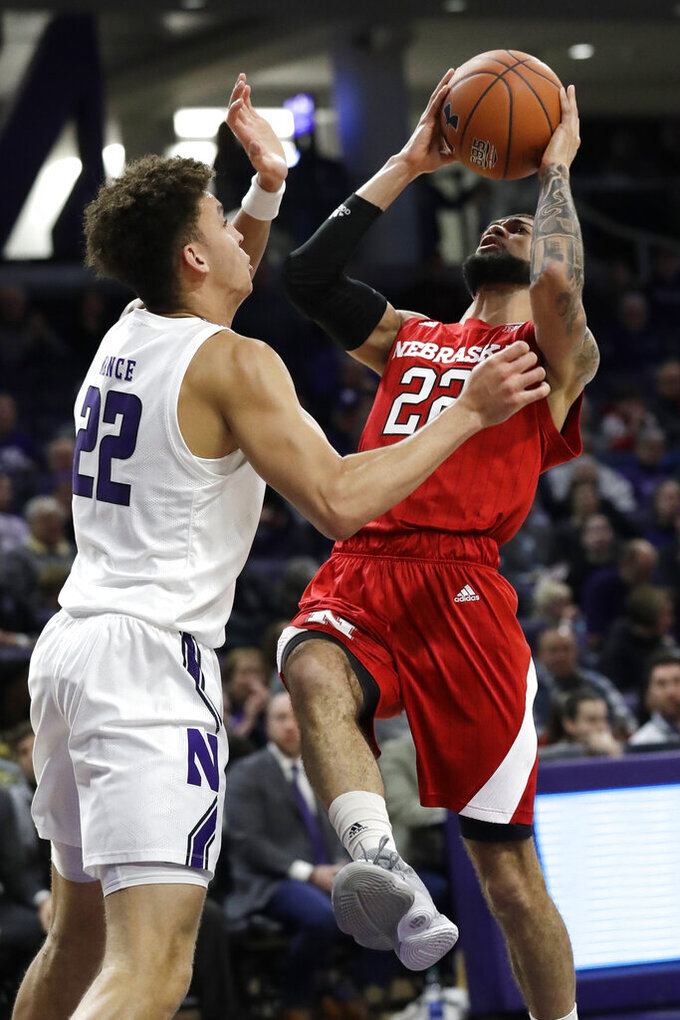 Nebraska guard Haanif Cheatham, right, shoots against Northwestern forward Pete Nance during the first half of an NCAA college basketball game in Evanston, Ill., Saturday, Jan. 11, 2020. (AP Photo/Nam Y. Huh)