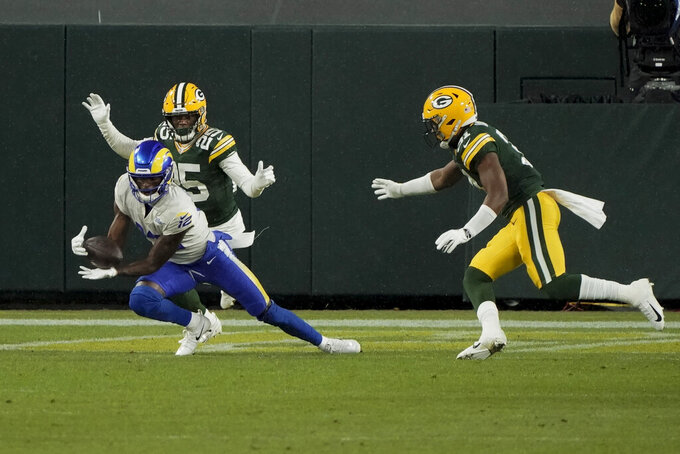 Los Angeles Rams' Van Jefferson (12) catches a four-yard touchdown past against the Green Bay Packers during the first half of an NFL divisional playoff football game Saturday, Jan. 16, 2021, in Green Bay, Wis. (AP Photo/Morry Gash)